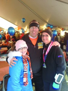 After running her first half-marathon, Sharon Harding poses with two of her supporters: Buddy Shuh and her daughter Kass.