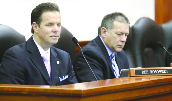 State Representative Robert Kosowski working in Committee.