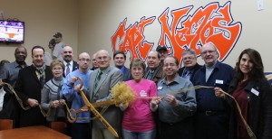 City officials and Chamber of Commerce members joined the staff at Captain Nemo's to celebrate their grand re-opening at their new location on Wayne Road next door to Seven Star Liquor. They now have a dine-in area in addition to their carry out counter.