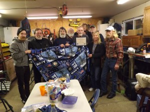 Dave (center holding certificate) and his family (sons Matt, far left and Rob (not pictured), and ex-wife Janet (back right)), welcomed Navy buddies, Keith Hurley, Jimmy Kernels, Mike Kelly, Bear Kemnets, Bob McAllister, Marty Martin, Bobby Piriak, John Potts, Bill Anderkin, Rick Phillips and their families.