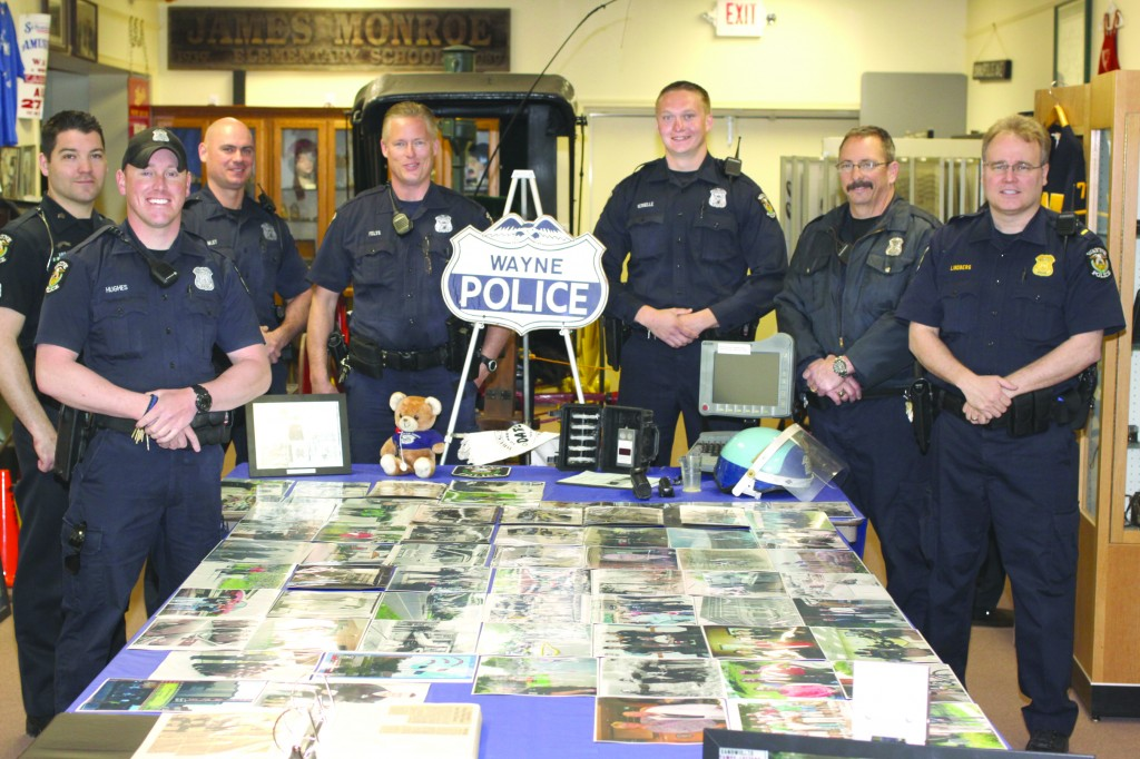 Wayne Police officers check out the Police display at the Wayne Historical Museum featuring photographs of the Wayne Police Department over the years, and the equipment used by the officers. The Museum is open Thursday and Friday 1 p.m. to 4 p.m.  The admission is always free.