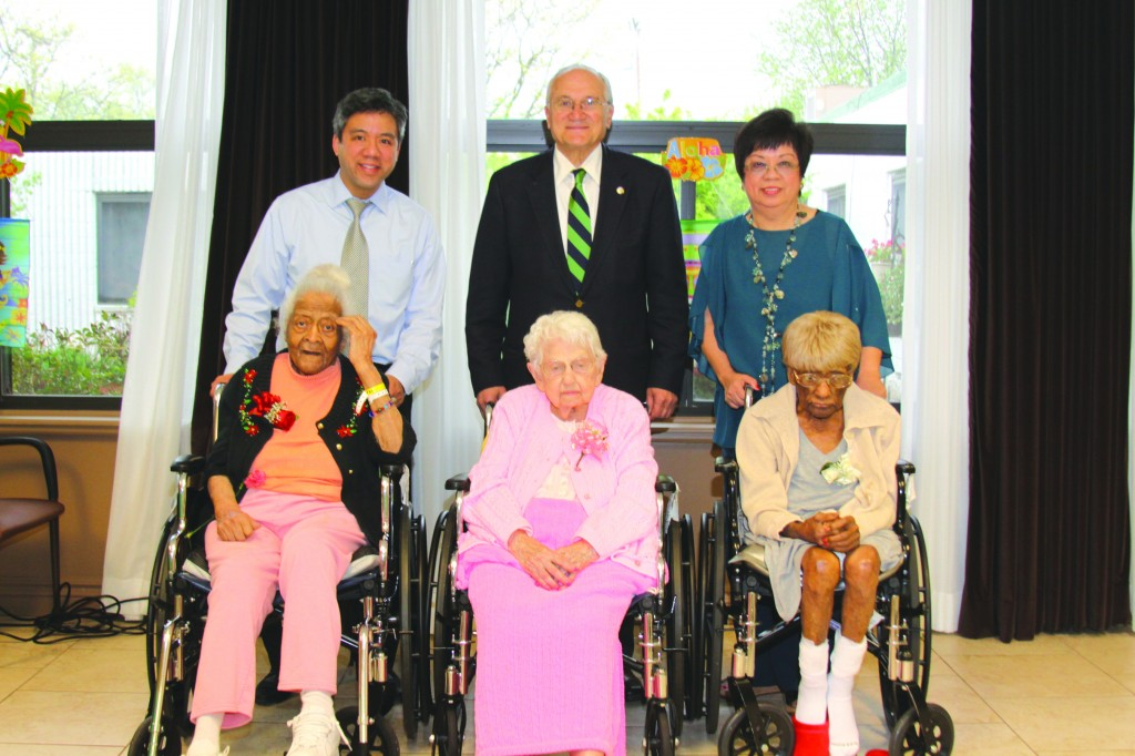 Maple Manor held an Aloha themed birthday party to celebrate the birthdays of three of their residents who were celebrating special milestones. (l-r): Ruby Johnson, 101, Edna Wooten, 102, and Mamie Williams, 102 were joined by Marcus Evangelista, attorney, Mayor Al Haidous and Dr. Stella Evangelista,  administrator and medical director of Maple Manor. Photo by John P. Rhaesa