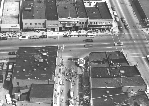 Looking westward on Michigan Avenue at Wayne Rd.  (Fessler's Restaurant is white building on the right side of picture with top of Mulholland's showing behind it.) Photo courtesy of The Wayne Historical Museum
