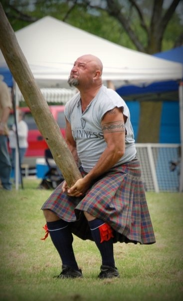 John Tracy in the caber toss. He is throwing an 18 ft. 80 lb. log for accuracy.