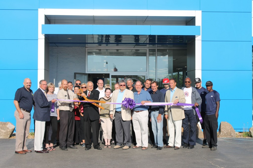 City officials and the staff at Mark Chevrolet celebrate the completion of the renovations with a ribbon cutting celebration.