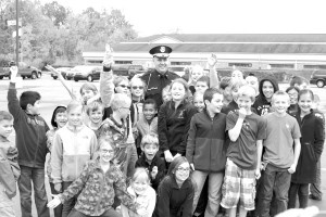 Hail to the Chief -  Students at St. Michael Lutheran School say goodbye to Police Chief Jason Wright who retired on Oct. 17. Photo John P. Rhaesa