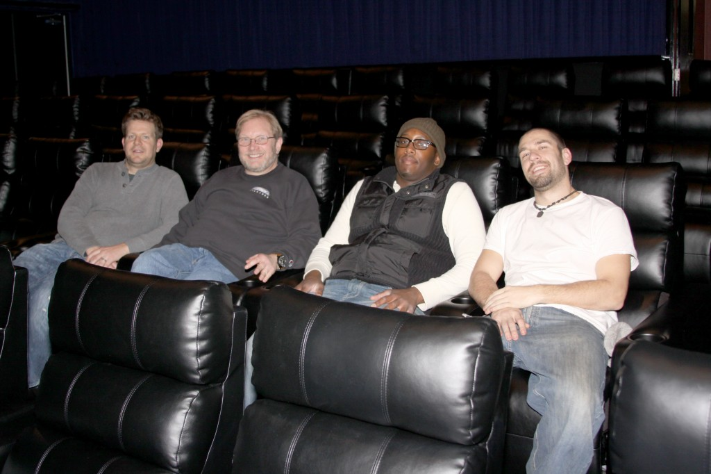 John Scanlan, Cory Jacobson, Tearis Reid and Joe Cork kick back and relax after installing the new luxury electric reclining seats. Photo by John P. Rhaesa