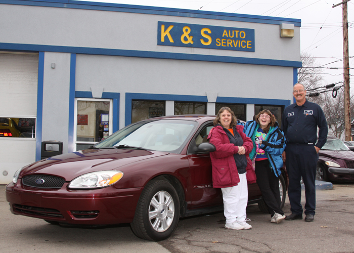 Thanks to Ray Kull (right), Frannie Dudash and her daughter, Rebecca, were surprised with a 2006 Taurus donated to her by K & S Auto Service in Wayne. Photo by John P. Rhaesa