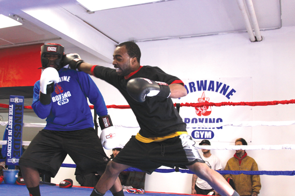 Amateurs spar in the ring on opening day of the gym.