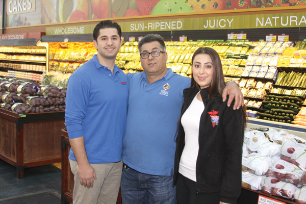 Fresh Choice Food Center- Jerry Pattah and his son, Tim, and daughter, Chanel, in the produce section of his new grocery store in Wayne. Photos by John P. Rhaesa