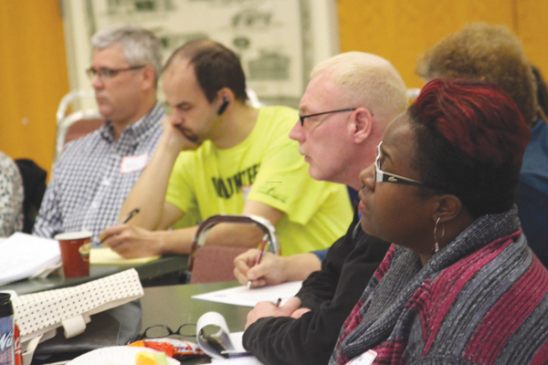 Community members discuss what's going on in the community and future partnerships with Wayne Main Street.