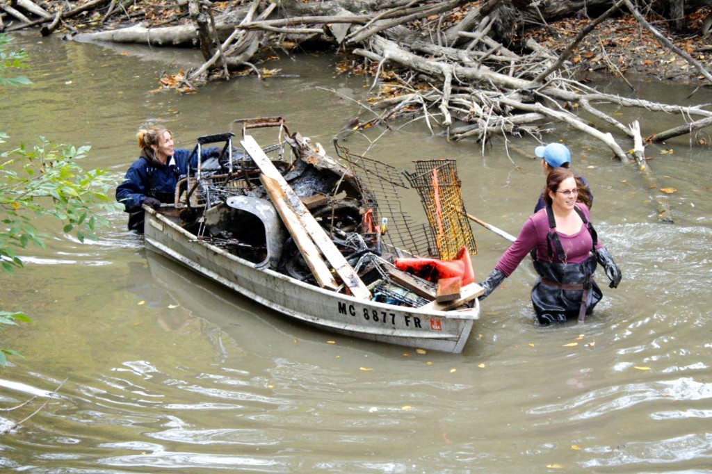 Volunteers remove debris from the Rouge River. This year's annual river clean up takes place on May 30.