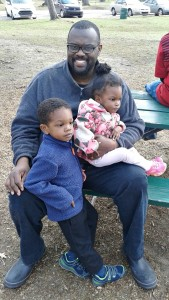 Conover enjoys an afternoon at the park with his son and daughter.