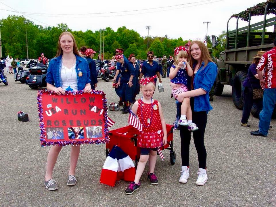 "Kelsey, Emily and Kaylee Shankin holding Skylar Webb walked in the Memorial Day Parade to honor their great grandma ""Rosie Ruth,"" Webb who worked during WW II building B-24 Bombers at Willow Run Bomber Plant."