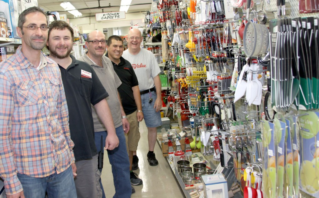 Sam Yono, Jordan Montgomery, Bashar Yono, Ken Dahn and Jim Cox in the new and improved houseware department at Northside Hardware. Photo by John P. Rhaesa
