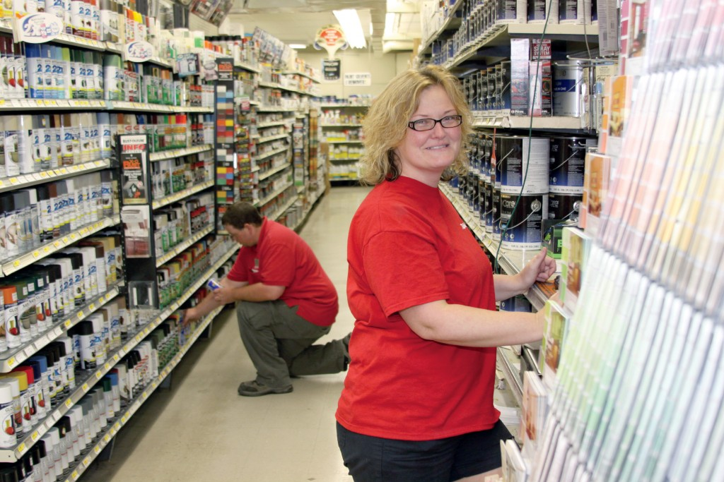 Brandon Tesner and Shonda Martin work in the newly updated paint aisle. Photo by John P. Rhaesa