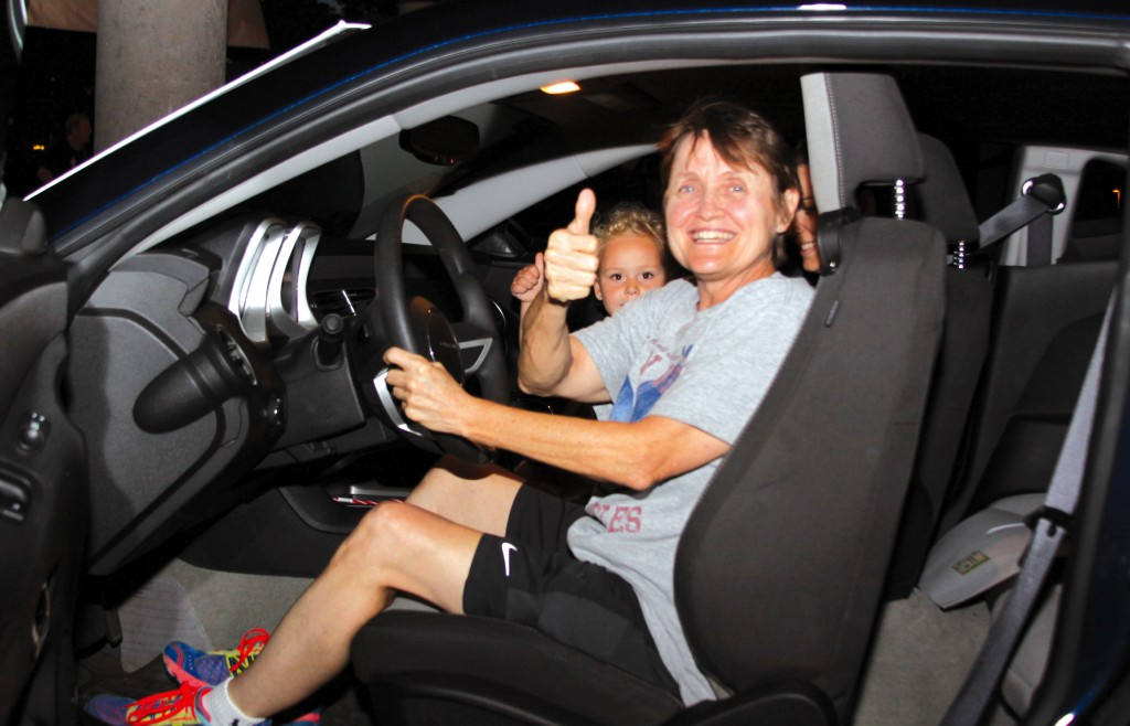 Carol Bevard gives a thumbs up after winning the Wayne Goodfellows Camaro Raffle. Photo by John Rhaesa