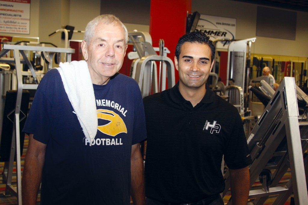 Long time recreation member Ron Hays is takes a break from his workout to take a picture with CEO of HYPE Athletics, Ali Sayed. Wayne Dispatch photo by John P. Rhaesa
