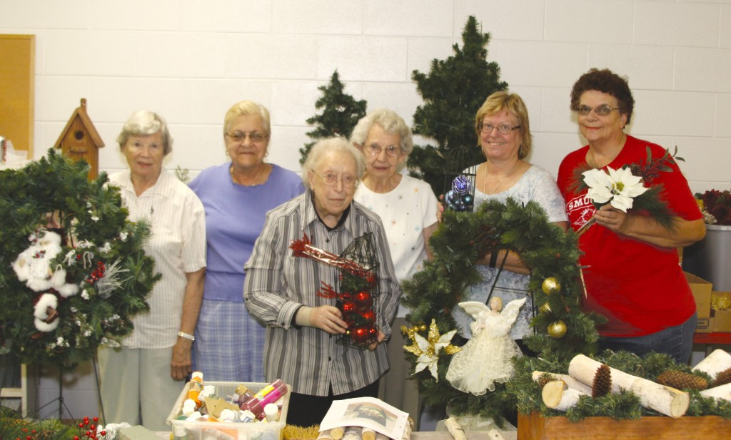 Lucille Cobenaw, Brenda Armstrong, Kathy Kovaleski, Miriam Shurlow, Mary Carney and Veronica Hoops show off some of the wreaths that will be sold on November 5th and 6th at The First Congregational Church.