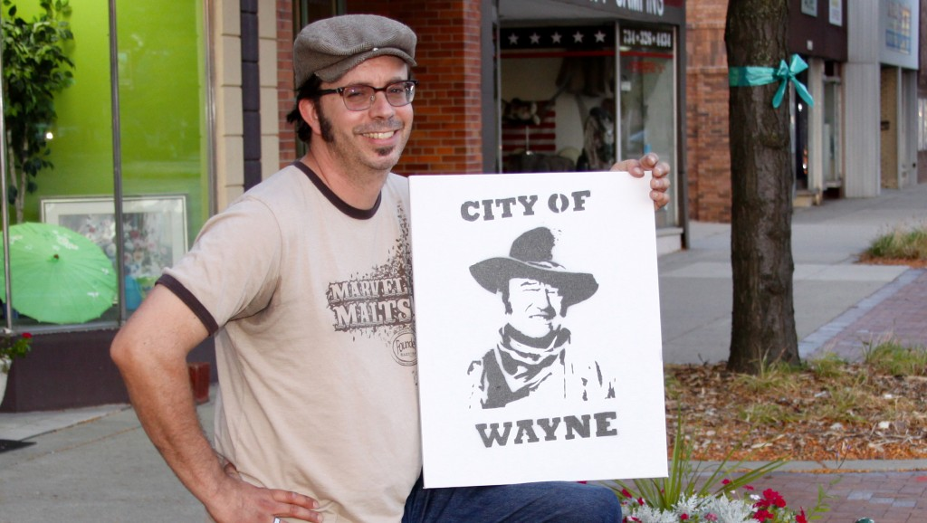 The artist behind the mysterious John Wayne posters over the past two years, Matt Rochon.