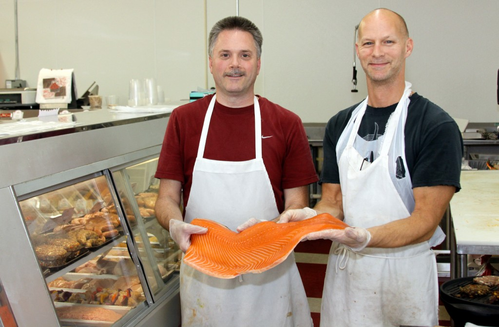 Matt Toyeas and Todd LaCoe show off fresh salmon at Prizmo's Market.