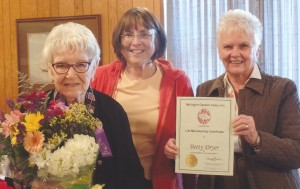 Betty Dryer is awarded a Michigan Garden Clubs, Inc. State Life Membership at the Wayne Garden Club's November meeting by Co-Presidents Tina Butler and Lois VanStipdonk.