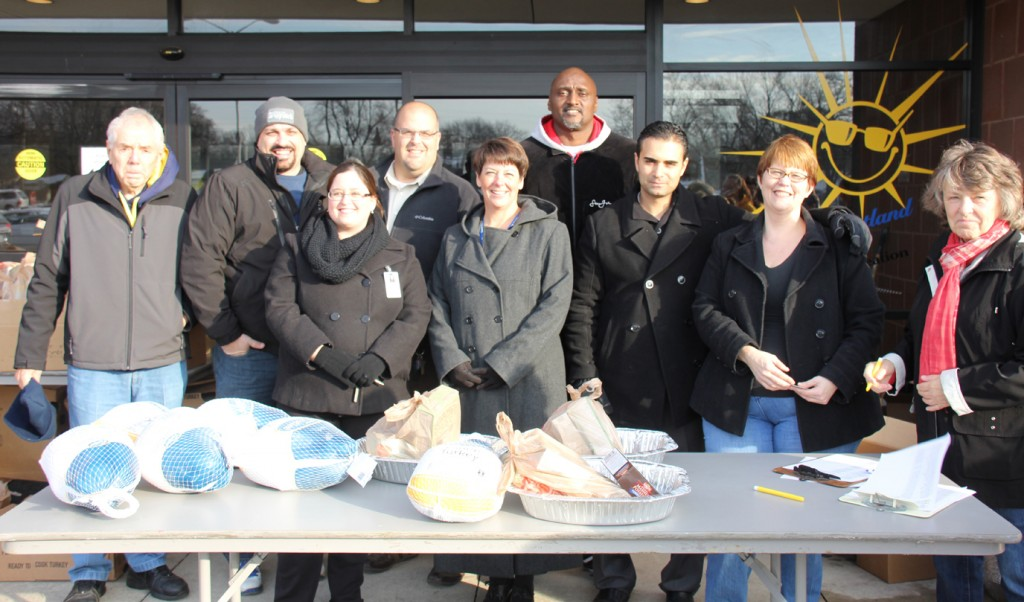Volunteers L-R: Corky Hayes, Councilman John Rhaesa, Amanda Dybus, Family Resource Center; Brian Haddad; Kelly Bohl, WWCS assistant superintendent,  Ali Sayed, CEO HYPE (front row third from right); Irene Ivanac, HYPE (second from right), Pat Hartford and Jenny Johnson (not pictured) helped pass out the Thanksgiving meals. Photo by Jenny Johnson