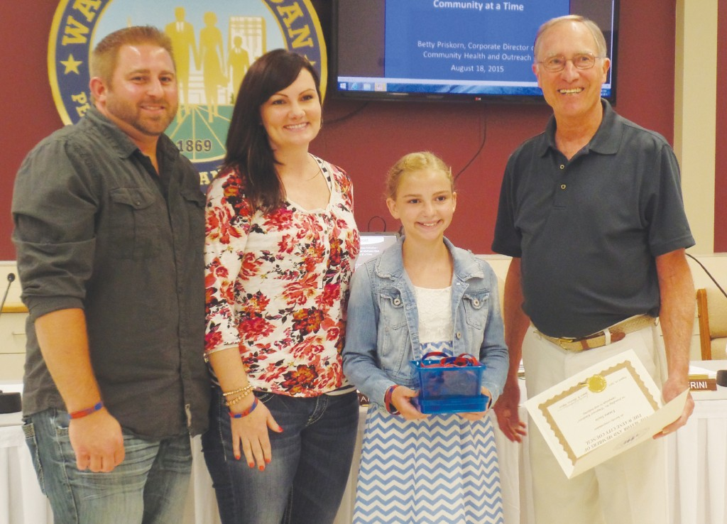 Keith and Teri Socia with their daughter Emma are presented with a cerificate from Mayor James Hawley for her anti-bullying efforts at a City Council meeting earlier this year.