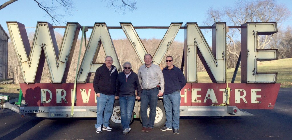 Standing in front of the Wayne Drive-In sign are Wayne Carini (second from left), Nathan Lippe (third from left) and two friends.