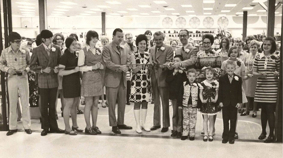 Ribbon cutting at the new Metro Mall location in 1970 with Mayor Pat Norton, Mr. and Mrs. James Collins (General Manager)and the Mulholland family.