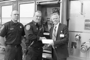 Captain Fred Gilstorff of the Wayne Fire Department, receives a check for $2,500 from Beaumont Hospital Division President Eric W. Widner towards the Jaws of Life. Photo by John Rhaesa