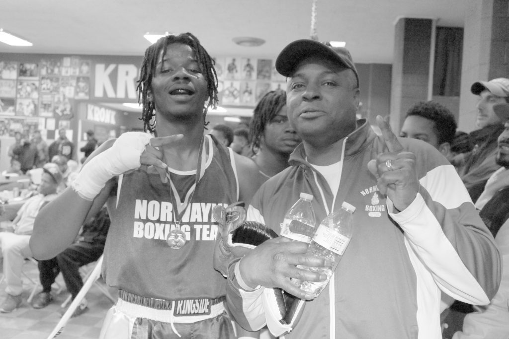 Husain Foxworth and Coach Erskine Wade from the Norwayne Boxing Gym after Husain won the Detroit Golden Gloves at the Kronk Gym in Detroit. Husain will represent Michigan in Salt Lake City, Utah later this year at United StatesNational Golden Gloves. Photo by John P. Rhaesa
