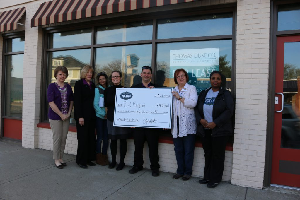 Wayne Main Street Board Members: Treasurer Cynthia Schofield, Pat Rice, secretary and design committee chair Carolyn Marnon, executive director Lindsey Wooten, president Cindee McClure and Theodora Brooks present property owner Paul Visingardi a check for $9,957.50 as the first recipient of the Wayne Main Street Façade Grant Incentive Program.