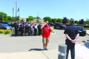 The Wayne Police salute newly retired Police Officer Lt. Puckett last month.