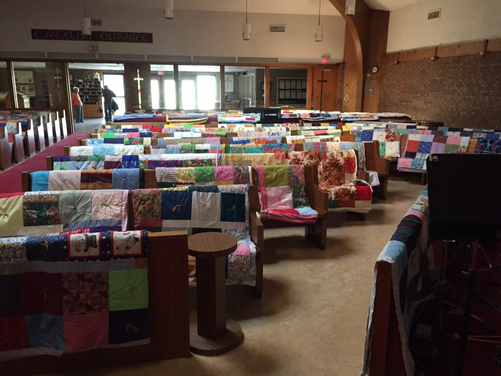 St. Michaels Lutheran Church draped 270 quilts on the pews of  their sanctuary to display them for their congregation, community and friends they will be packed and shipped by train to the Lutheran World Relief Center to be distributed throughout the world to those in need.